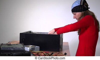 technician girl remove motherboard from desktop computer and...