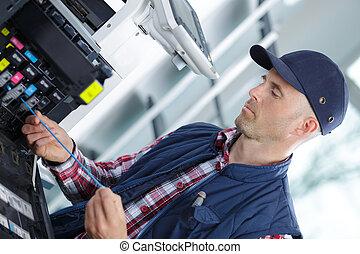 technician man repairing photocopy machine