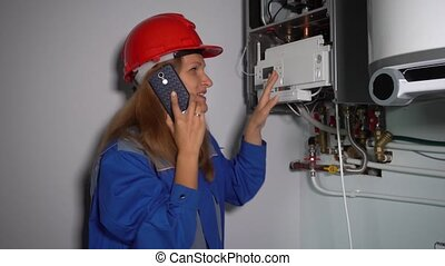 Technician polite woman talking with her boss or client on phone. Static shot.