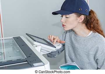 Technician programming photocopier