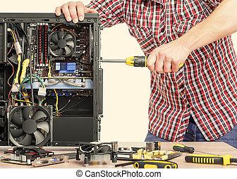 Technician repair assembles computer.