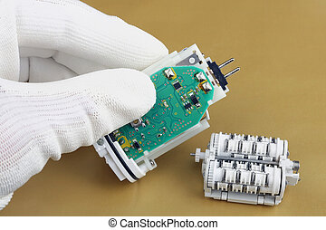 Technician repair the  used epilator-  electro mechanical device with battery and motor