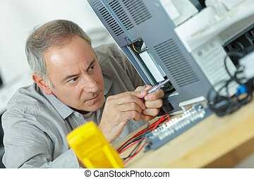 technician repairing a pc