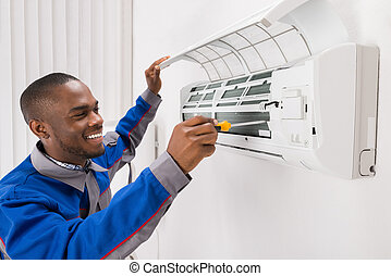 Technician Repairing Air Conditioner - Happy Young African...