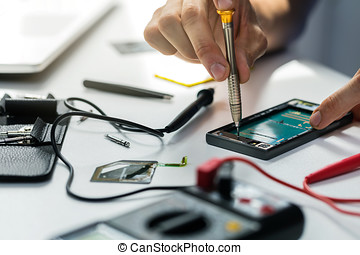 technician repairing broken phone