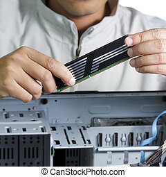 Technician repairing computer hardware
