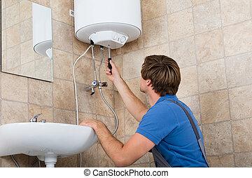 Technician Repairing Electric Boiler
