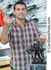 technician reparing gear in a bike shop