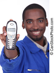 Technician showing landline phone