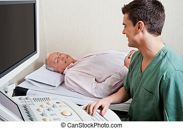 Technician Smiling At Patient