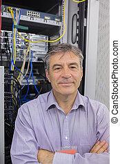 Technician standing in front of servers