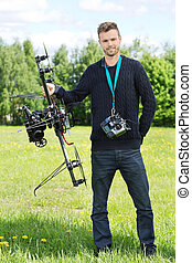 Technician Standing With UAV - Portrait of confident...