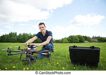 Technician With Octocopter Drone in Park