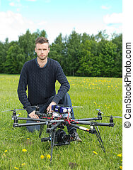 Technician With UAV Drone in Park