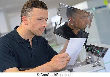 technician worker checking a metal machine