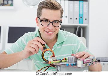 Technician working on broken cpu with screwdriver