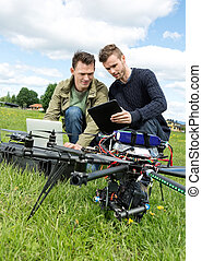 Technicians Discussing Over Digital Tablet By UAV