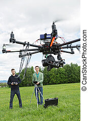 Technicians Flying UAV Spy Drone