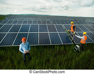 technicians inspecting solar panel station