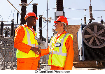 technicians meeting in electrical substation