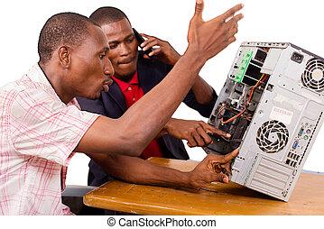 technicians repairing a computer