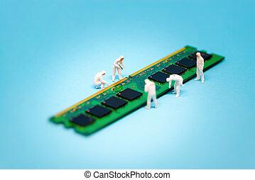 Technicians repairing computer RAM module
