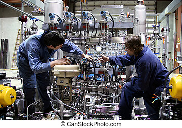 Technicians - Two technician carry out the last inspection...