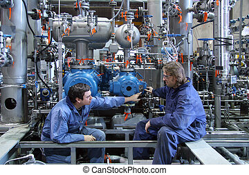 Technicians - Two technicians on a new gas compressor