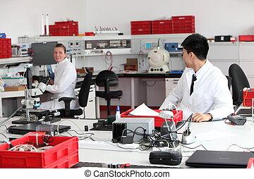Technicians working in a modern laboratory