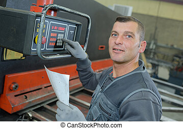 technicien using a electronic device in factory