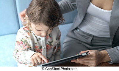 Technological Activity - High angle view of little girl...