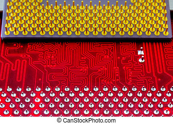 Technological background with red computer motherboard and central processing unit