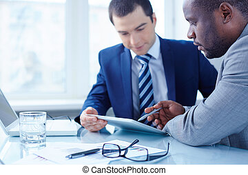 Technologies in business - Image of two young businessmen...