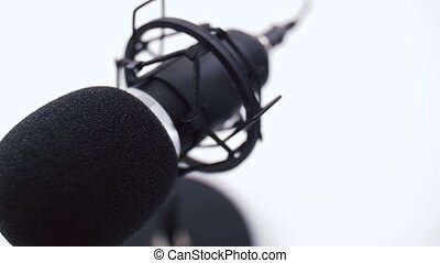 close up of microphone at recording studio - technology and ...