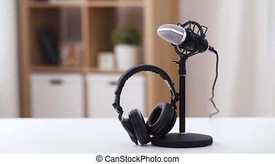headphones and microphone at home office - technology and ...
