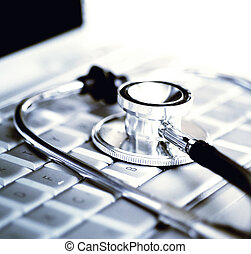 Technology and medicine - Silver stethoscope over laptop...