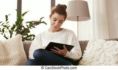 woman with tablet pc computer at home - technology and...