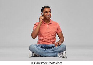 happy indian man calling on smartphone