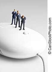 Technology for small business - Businessman figurines placed...