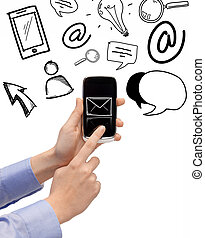 hand holding smartphone with email icon