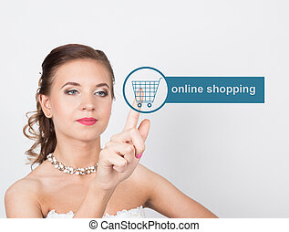 technology, internet and networking concept. Beautiful bride in fashion wedding dress. Bride presses online shopping button on virtual screens