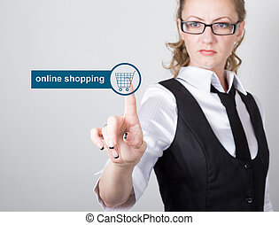 technology, internet and networking concept. beautiful woman in a black business shirt. woman presses online shopping button on virtual screens