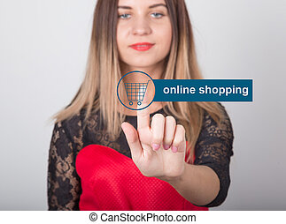 technology, internet and networking concept. beautiful woman in a red dress with lace sleeves. woman presses online shopping button on virtual screens
