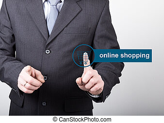 technology, internet and networking concept - Businessman presses online shopping button on virtual screens. Internet technologies in business