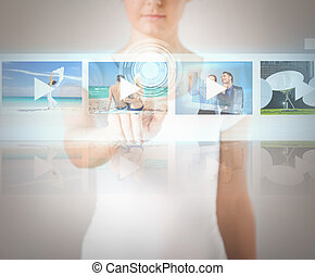 woman pressing button on virtual screen