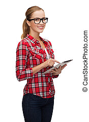 smiling girl in eyeglasses with tablet pc computer
