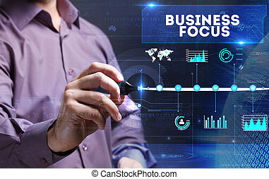 Technology, internet, business and marketing. Young business man writing word: business focus