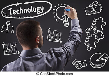 Technology, internet, business and marketing. Young business man writing word: Technology