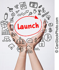 Technology, internet, business and marketing. Young business woman writing word: Launch