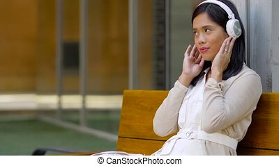 asian woman with smartphone and headphones - technology,...